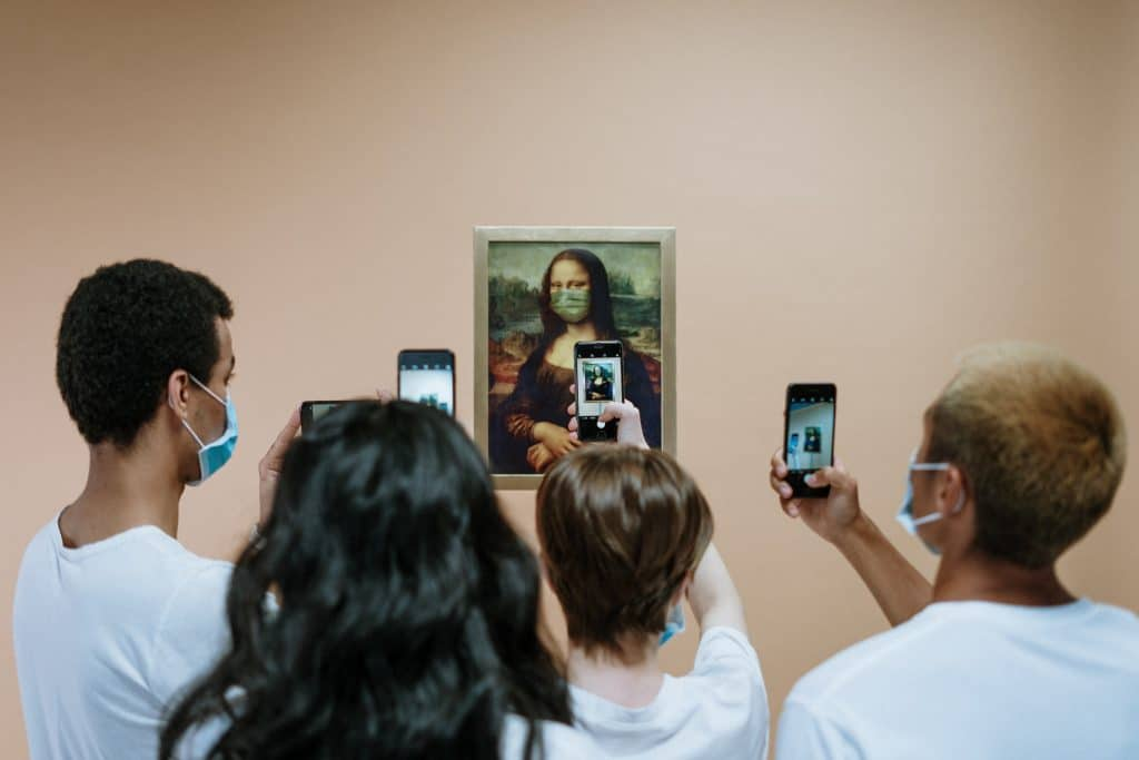 People Taking Picture of a Painting