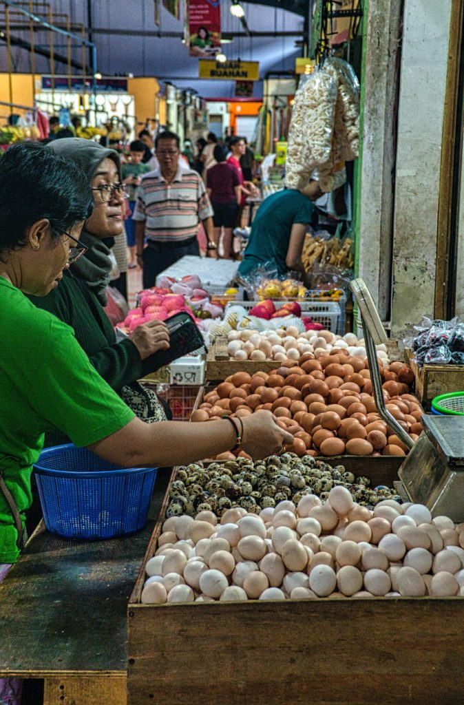 photo-of-people-standing-in-front-of-vegetable-stall-3691112-3-scaled.jpg