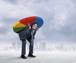 Businessman Carrying Pie Chart On His Back